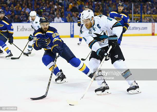 Joe Pavelski of the San Jose Sharks skates with the puck against Kevin Shattenkirk of the St Louis Blues during the second period in Game One of the...