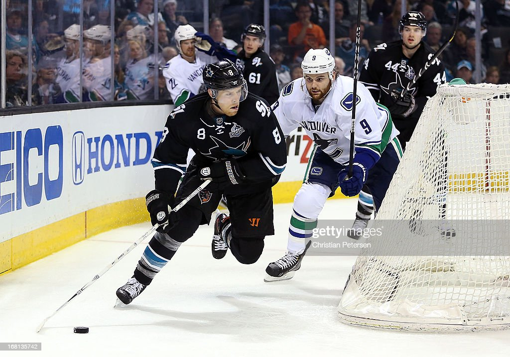 <a gi-track='captionPersonalityLinkClicked' href=/galleries/search?phrase=Joe+Pavelski&family=editorial&specificpeople=687042 ng-click='$event.stopPropagation()'>Joe Pavelski</a> #8 of the San Jose Sharks skates with the puck ahead of <a gi-track='captionPersonalityLinkClicked' href=/galleries/search?phrase=Zack+Kassian&family=editorial&specificpeople=4604939 ng-click='$event.stopPropagation()'>Zack Kassian</a> #9 of the Vancouver Canucks in Game Three of the Western Conference Quarterfinals during the 2013 NHL Stanley Cup Playoffs at HP Pavilion on May 5, 2013 in San Jose, California. The Sharks defeated the Canucks 5-2.