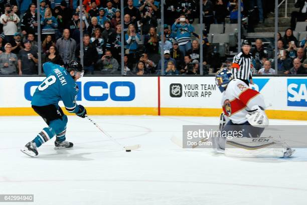 Joe Pavelski of the San Jose Sharks takes a penalty shot which Roberto Luongo of the Florida Panthers blocks during a NHL game at SAP Center at San...