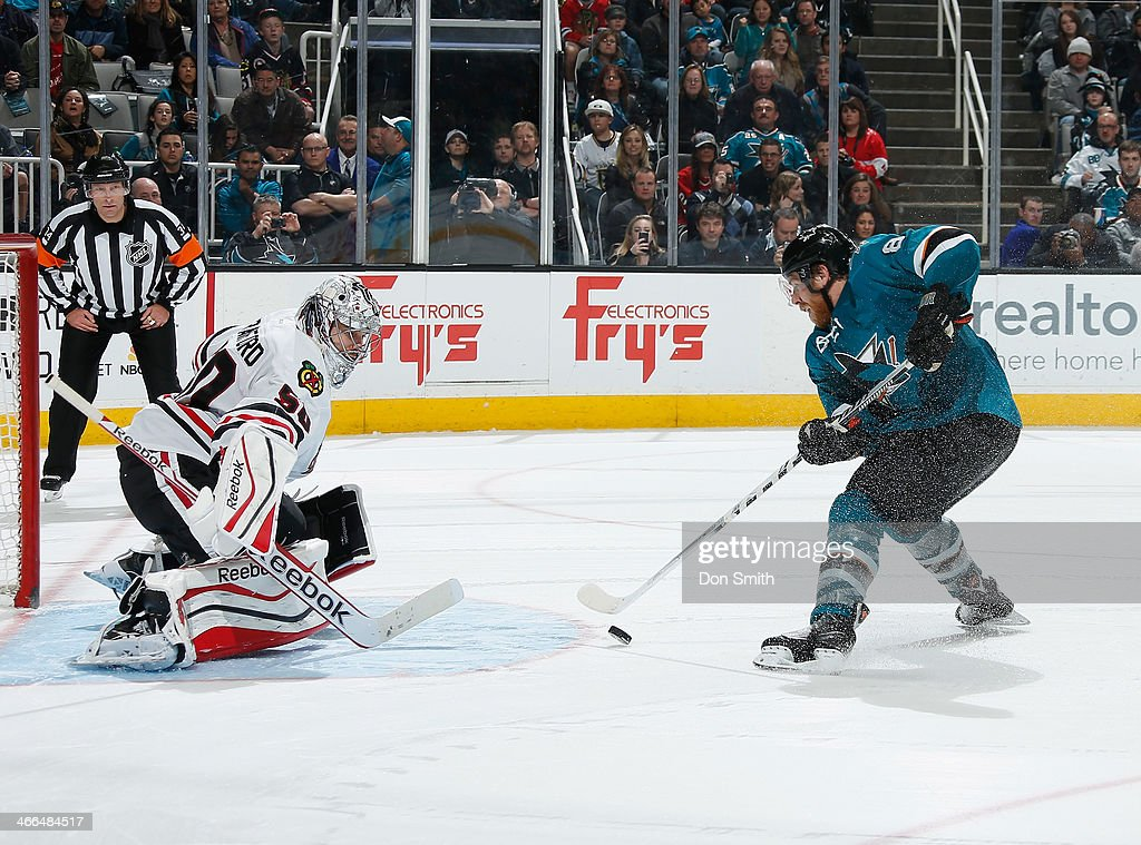 Joe Pavelski #8 of the San Jose Sharks takes a shot in the shootout against Corey Crawford #50 of the Chicago Blackhawks during an NHL game on February 1, 2014 at SAP Center in San Jose, California.