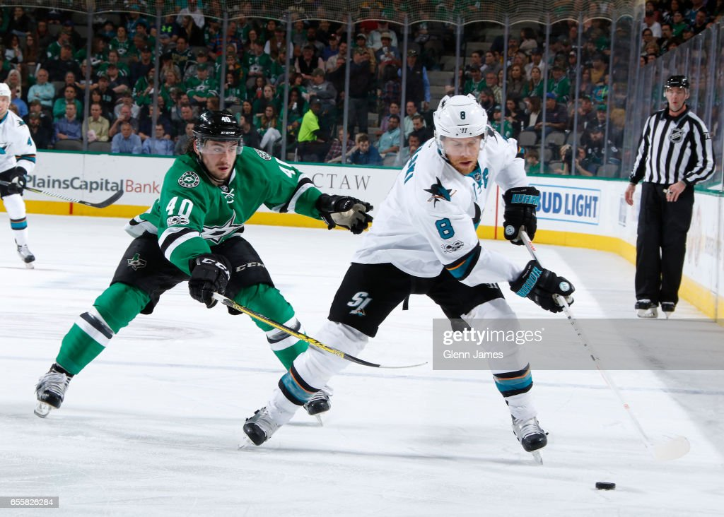 Joe Pavelski #8 of the San Jose Sharks tries to keep the puck away against Remi Elie #40 of the Dallas Stars at the American Airlines Center on March 20, 2017 in Dallas, Texas.