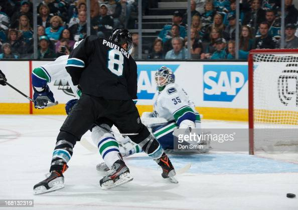 Joe Pavelski of the San Jose Sharks tries to score against Cory Schneider of the Vancouver Canucks in Game One of the Western Conference...