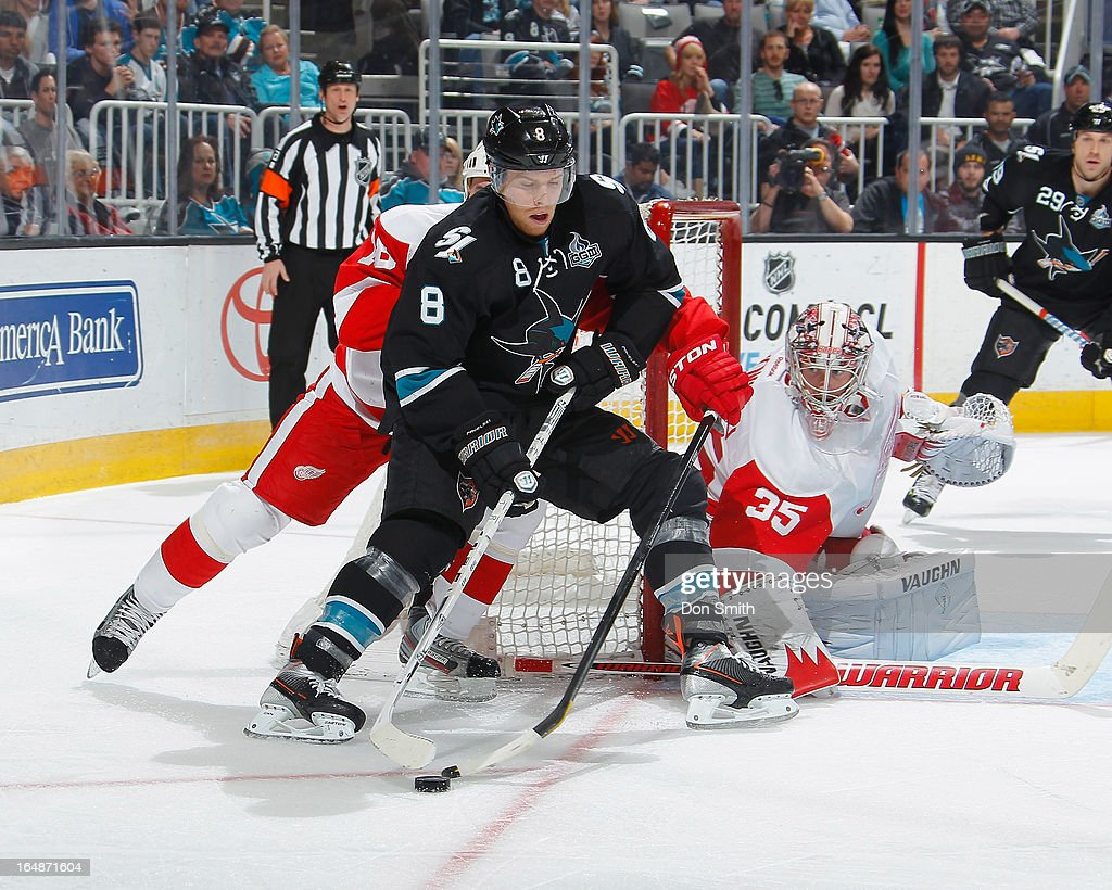 <a gi-track='captionPersonalityLinkClicked' href=/galleries/search?phrase=Joe+Pavelski&family=editorial&specificpeople=687042 ng-click='$event.stopPropagation()'>Joe Pavelski</a> #8 of the San Jose Sharks tries to score against <a gi-track='captionPersonalityLinkClicked' href=/galleries/search?phrase=Jimmy+Howard&family=editorial&specificpeople=2118637 ng-click='$event.stopPropagation()'>Jimmy Howard</a> #35 of the Detroit Red Wings during an NHL game on March 28, 2013 at HP Pavilion in San Jose, California.
