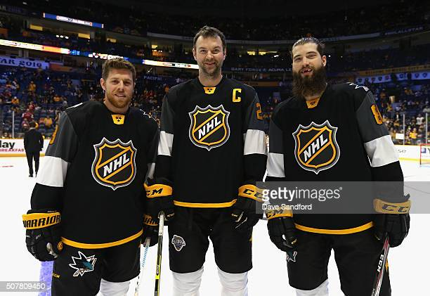Joe Pavelski of the San Jose SharPacific Division AllStars John Scott of the Arizona Coyotes and Brent Burns of the San Jose Sharks look on during...