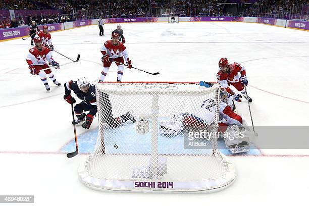 Joe Pavelski of the United States scores a thirdperiod goal against Sergei Bobrovski of Russia during the Men's Ice Hockey Preliminary Round Group A...