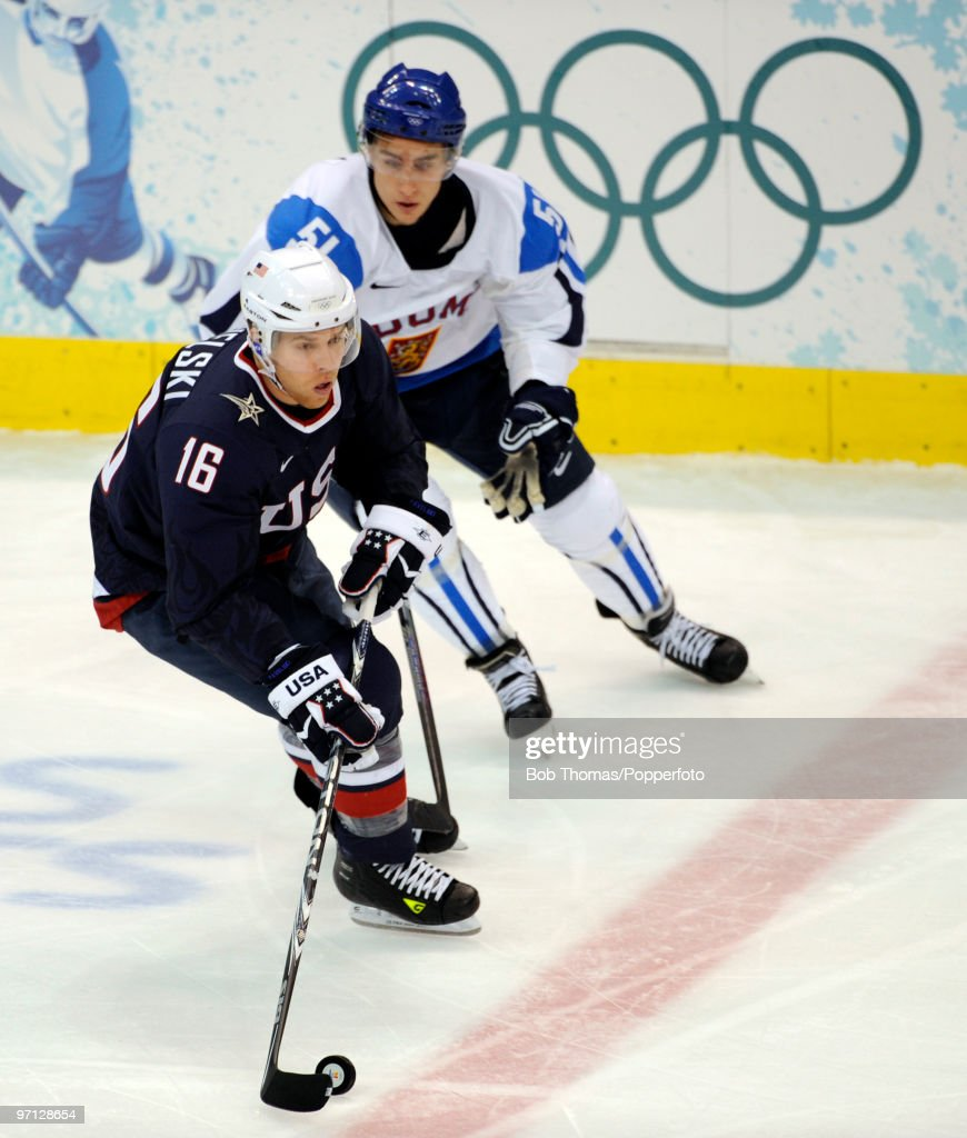 Joe Pavelski of the USA with Valtteri Filppula of Finland during the ice hockey men's semifinal game between the United States and Finland on day 15...