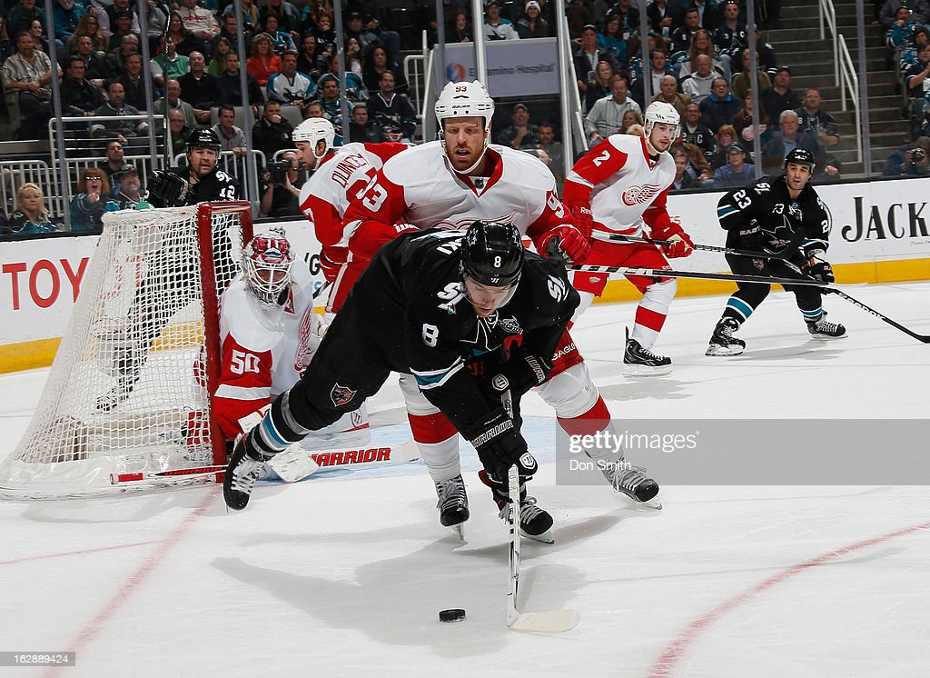 <a gi-track='captionPersonalityLinkClicked' href=/galleries/search?phrase=Joe+Pavelski&family=editorial&specificpeople=687042 ng-click='$event.stopPropagation()'>Joe Pavelski</a> #8, <a gi-track='captionPersonalityLinkClicked' href=/galleries/search?phrase=Patrick+Marleau&family=editorial&specificpeople=203165 ng-click='$event.stopPropagation()'>Patrick Marleau</a> #12 and <a gi-track='captionPersonalityLinkClicked' href=/galleries/search?phrase=Scott+Gomez&family=editorial&specificpeople=201782 ng-click='$event.stopPropagation()'>Scott Gomez</a> #23 of the San Jose Sharks handles the puck in the offensive zone against <a gi-track='captionPersonalityLinkClicked' href=/galleries/search?phrase=Jonas+Gustavsson&family=editorial&specificpeople=886789 ng-click='$event.stopPropagation()'>Jonas Gustavsson</a> #50, <a gi-track='captionPersonalityLinkClicked' href=/galleries/search?phrase=Johan+Franzen&family=editorial&specificpeople=624356 ng-click='$event.stopPropagation()'>Johan Franzen</a> #93, Brendan Smith #2 and <a gi-track='captionPersonalityLinkClicked' href=/galleries/search?phrase=Kyle+Quincey&family=editorial&specificpeople=2234340 ng-click='$event.stopPropagation()'>Kyle Quincey</a> #27 of the Detroit Red Wings during an NHL game on February 28, 2013 at HP Pavilion in San Jose, California.
