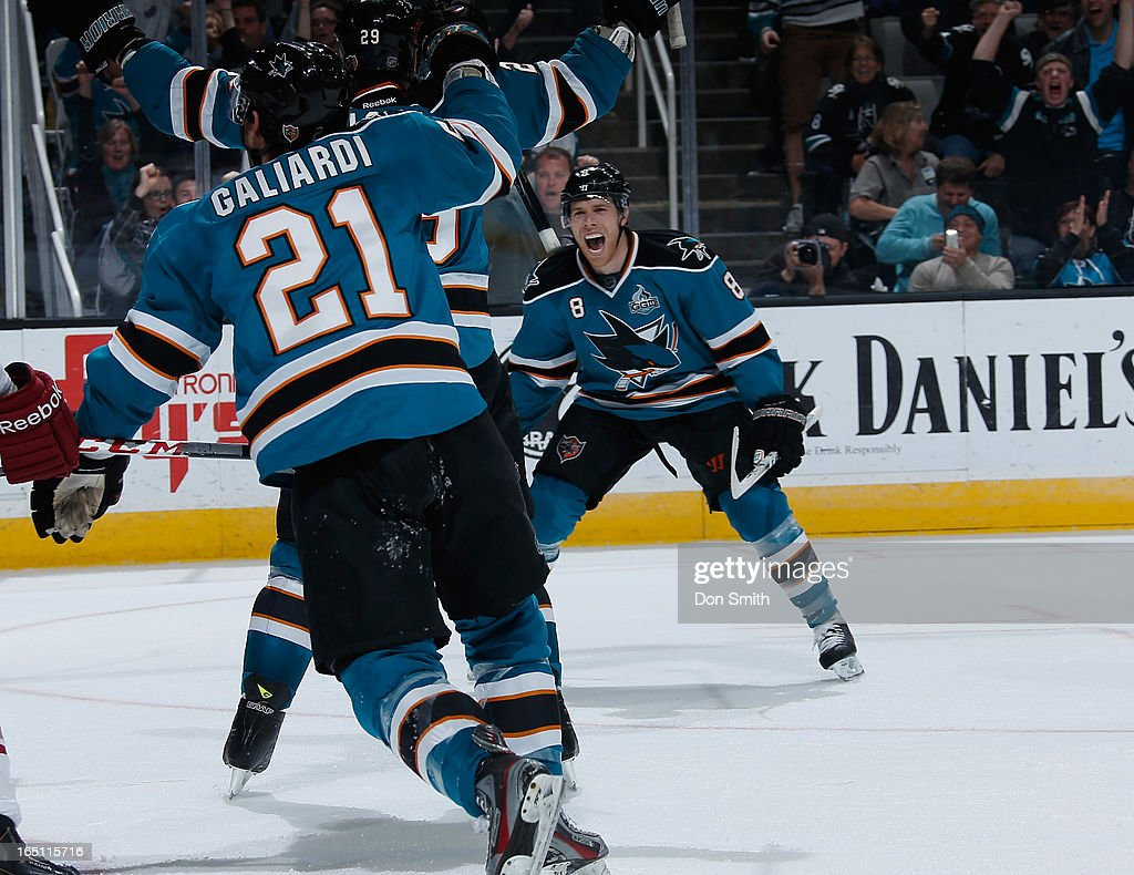 <a gi-track='captionPersonalityLinkClicked' href=/galleries/search?phrase=Joe+Pavelski&family=editorial&specificpeople=687042 ng-click='$event.stopPropagation()'>Joe Pavelski</a> #8, <a gi-track='captionPersonalityLinkClicked' href=/galleries/search?phrase=Ryane+Clowe&family=editorial&specificpeople=736658 ng-click='$event.stopPropagation()'>Ryane Clowe</a> #29 and TJ Galiardi #21 of the San Jose Sharks celebrate a goal against the Phoenix Coyotes during an NHL game on March 30, 2013 at HP Pavilion in San Jose, California.