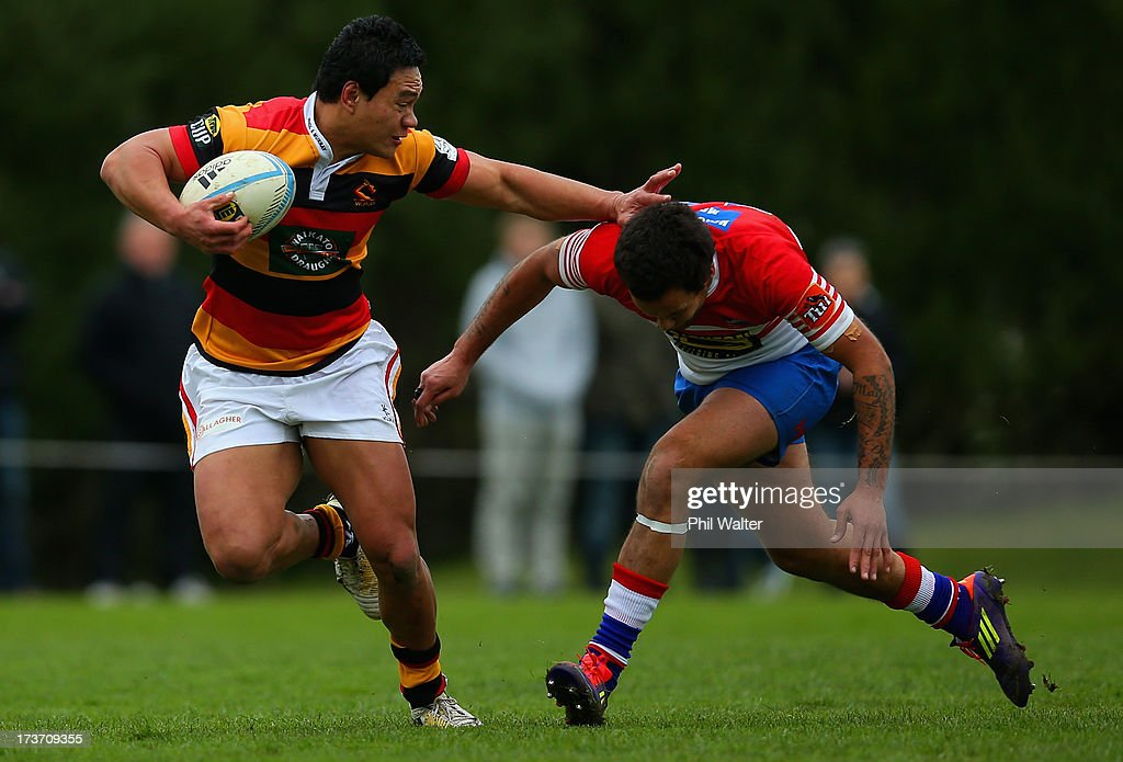 Joe Perawiti of Waikato is tackled by James Forsythe of Horowhenua-Kapiti during the Ranfurly Shield match between Waikato and Horowhenua-Kapiti at the Morrinsville Domain on July 17, 2013 in Morrinsville, New Zealand.
