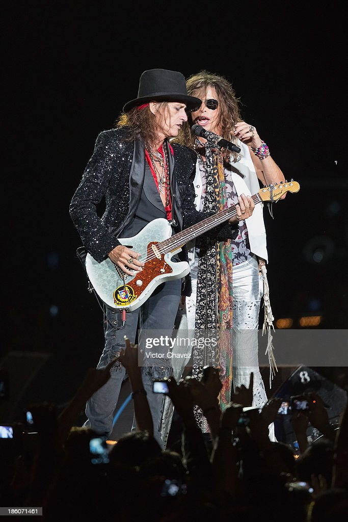 Joe Perry and singer Steven Tyler of Aerosmith perform on stage at Arena Ciudad de México on October 27, 2013 in Mexico City, Mexico.