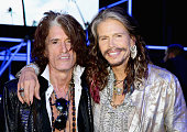 Joe Perry and Steven Tyler attend the Roberto Cavalli show during the Milan Menswear Fashion Week Spring Summer 2015 on June 24 2014 in Milan Italy