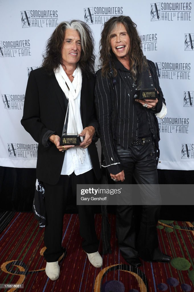 <a gi-track='captionPersonalityLinkClicked' href=/galleries/search?phrase=Joe+Perry+-+Musician&family=editorial&specificpeople=13600677 ng-click='$event.stopPropagation()'>Joe Perry</a> and <a gi-track='captionPersonalityLinkClicked' href=/galleries/search?phrase=Steven+Tyler+-+Musician&family=editorial&specificpeople=202080 ng-click='$event.stopPropagation()'>Steven Tyler</a> of Aerosmith attend the Songwriters Hall of Fame 44th Annual Induction and Awards Dinner at the New York Marriott Marquis on June 13, 2013 in New York City.