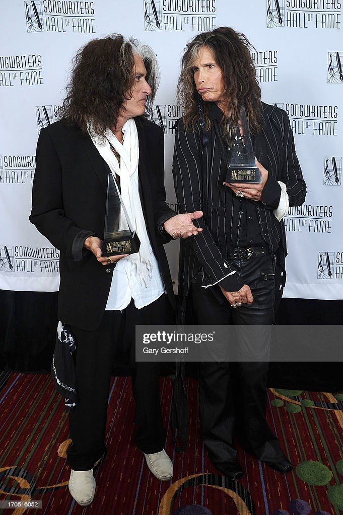 <a gi-track='captionPersonalityLinkClicked' href=/galleries/search?phrase=Joe+Perry+-+Musicien&family=editorial&specificpeople=13600677 ng-click='$event.stopPropagation()'>Joe Perry</a> and <a gi-track='captionPersonalityLinkClicked' href=/galleries/search?phrase=Steven+Tyler&family=editorial&specificpeople=202080 ng-click='$event.stopPropagation()'>Steven Tyler</a> of Aerosmith attend the Songwriters Hall of Fame 44th Annual Induction and Awards Dinner at the New York Marriott Marquis on June 13, 2013 in New York City.