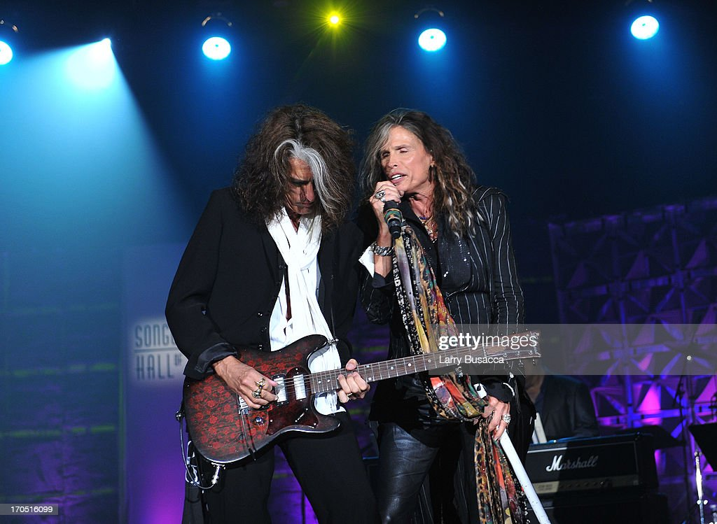 Joe Perry and Steven Tyler of Aerosmith perform at the Songwriters Hall of Fame 44th Annual Induction and Awards Dinner at the New York Marriott Marquis on June 13, 2013 in New York City.