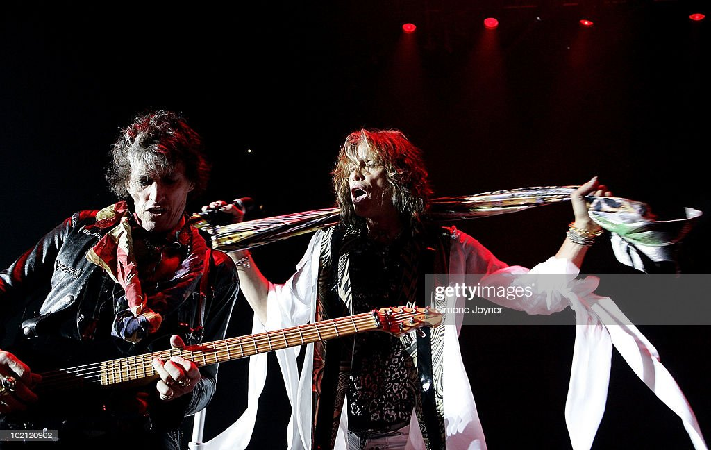 Joe Perry and Steven Tyler of Aerosmith perform live on stage as part of their 'Cocked, Locked, Ready To Rock' tour at the O2 Arena on June 15, 2010 in London, England.