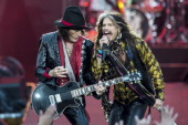 Joe Perry and Steven Tyler of Aerosmith perform on stage at Calling Festival at Clapham Common on June 28 2014 in London United Kingdom