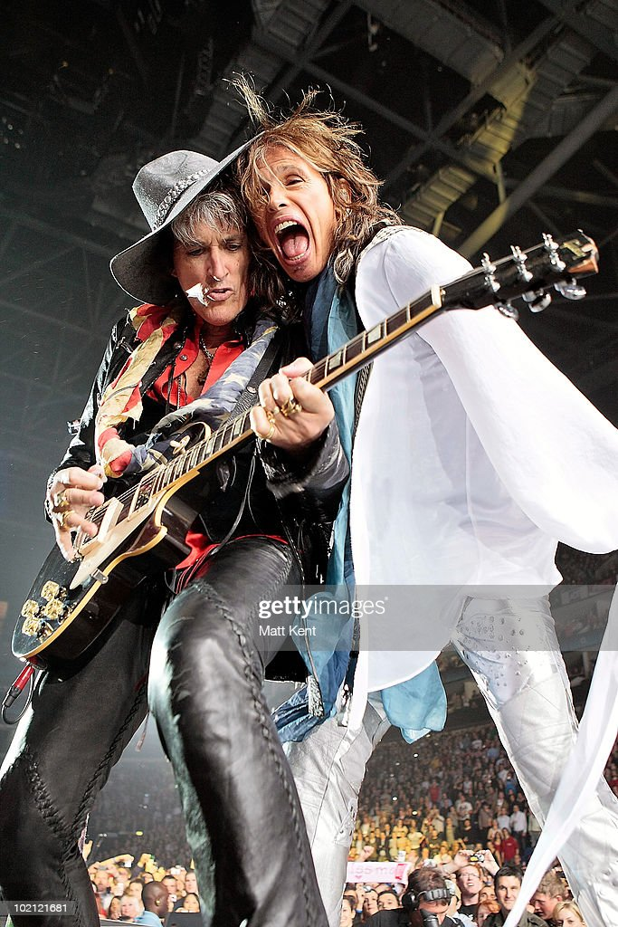 Joe Perry (R) and Steven Tyler of Aerosmith performs at 02 Arena on June 15, 2010 in London, England.