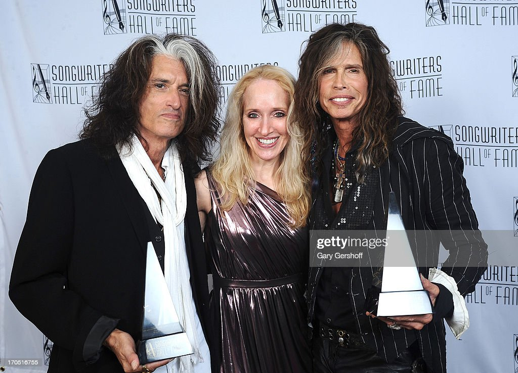 Joe Perry and Steven Tyler of Aerosmith pose with April Anderson (C) at Songwriters Hall of Fame 44th Annual Induction and Awards Dinner at the New York Marriott Marquis on June 13, 2013 in New York City.