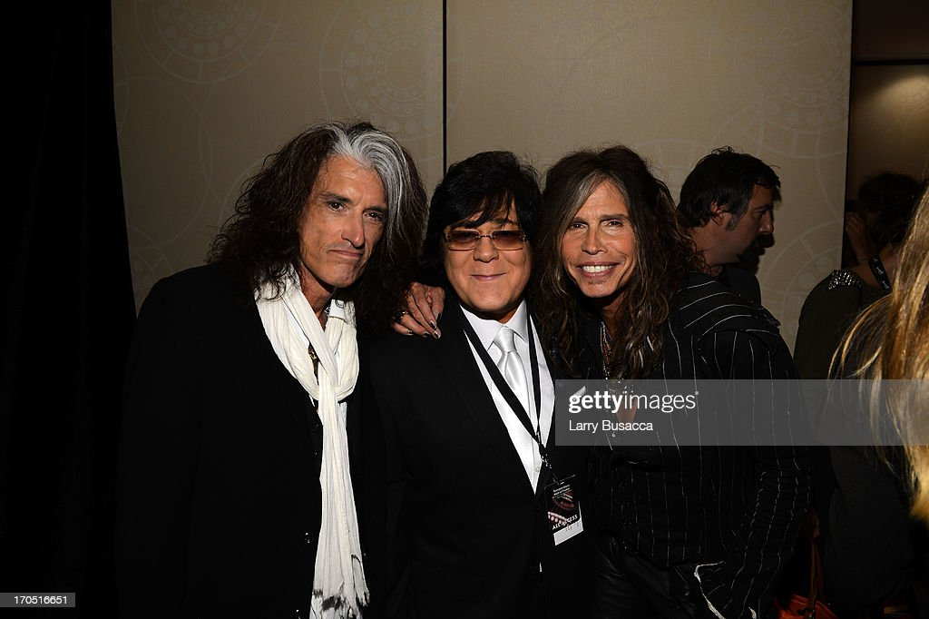 Joe Perry and Steven Tyler of Aerosmith pose with SHOF Board Member, John Titta (C) at the Songwriters Hall of Fame 44th Annual Induction and Awards Dinner at the New York Marriott Marquis on June 13, 2013 in New York City.