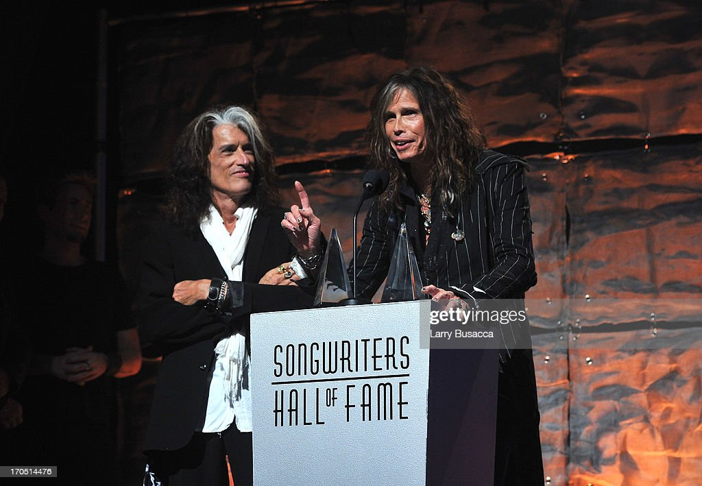 <a gi-track='captionPersonalityLinkClicked' href=/galleries/search?phrase=Joe+Perry+-+Musicien&family=editorial&specificpeople=13600677 ng-click='$event.stopPropagation()'>Joe Perry</a> and <a gi-track='captionPersonalityLinkClicked' href=/galleries/search?phrase=Steven+Tyler&family=editorial&specificpeople=202080 ng-click='$event.stopPropagation()'>Steven Tyler</a> of Aerosmith speak at the Songwriters Hall of Fame 44th Annual Induction and Awards Dinner at the New York Marriott Marquis on June 13, 2013 in New York City.