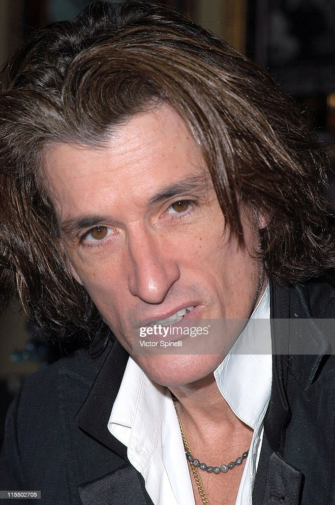 <a gi-track='captionPersonalityLinkClicked' href=/galleries/search?phrase=Joe+Perry+-+Musician&family=editorial&specificpeople=13600677 ng-click='$event.stopPropagation()'>Joe Perry</a> of <a gi-track='captionPersonalityLinkClicked' href=/galleries/search?phrase=Aerosmith&family=editorial&specificpeople=640712 ng-click='$event.stopPropagation()'>Aerosmith</a> during <a gi-track='captionPersonalityLinkClicked' href=/galleries/search?phrase=Joe+Perry+-+Musician&family=editorial&specificpeople=13600677 ng-click='$event.stopPropagation()'>Joe Perry</a> of <a gi-track='captionPersonalityLinkClicked' href=/galleries/search?phrase=Aerosmith&family=editorial&specificpeople=640712 ng-click='$event.stopPropagation()'>Aerosmith</a> Launches His 'Rock Your World' Hot Sauce at the Beverly Hills Hard Rock Cafe at Hard Rock Cafe in Beverly Hills, California, United States.