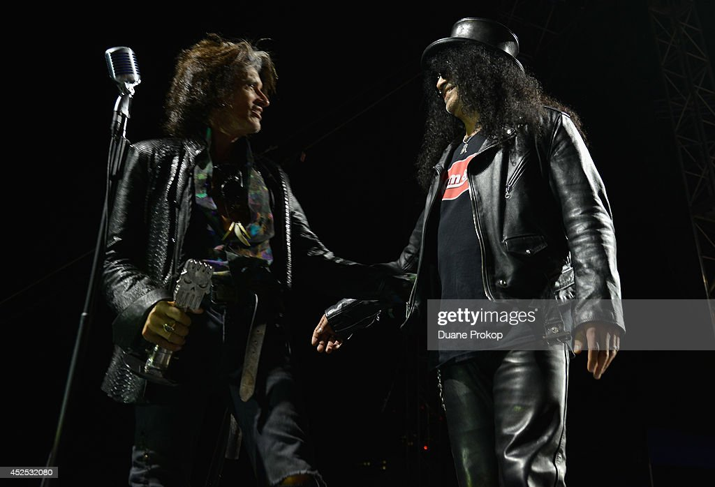Joe Perry of Aerosmith, left, presents Slash with the AP Guitar Legend Award at the 2014 Gibson Brands AP Music Awards at the Rock and Roll Hall of Fame and Museum on July 21, 2014 in Cleveland, Ohio.