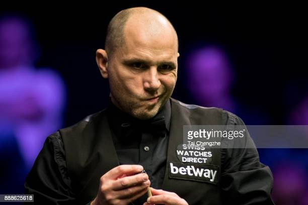Joe Perry of England chalks the cue during his quarterfinal match against Stephen Maguire of Scotland on day 12 of 2017 Betway UK Championship at...