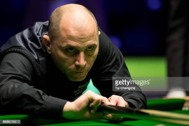 Joe Perry of England plays a shot during his quarterfinal match against Stephen Maguire of Scotland on day 12 of 2017 Betway UK Championship at...