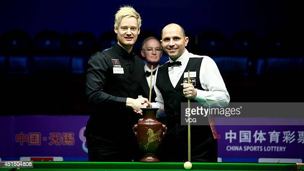 Joe Perry of England shakes hands with Neil Robertson of Australia prior to their final match on day seven of the 2014 World Snooker Wuxi Classic at...