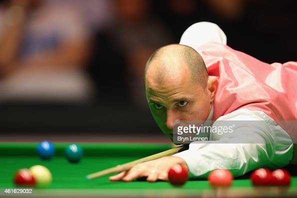 Joe Perry of Great Britain in action during his quarterfinal match against Mark Allen day six of the Dafabet Masters at Alexandra Palace on January...