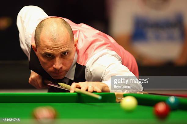 Joe Perry of Great Britain in action during his quarterfinal match against Mark Allen on day six of the Dafabet Masters at Alexandra Palace on...