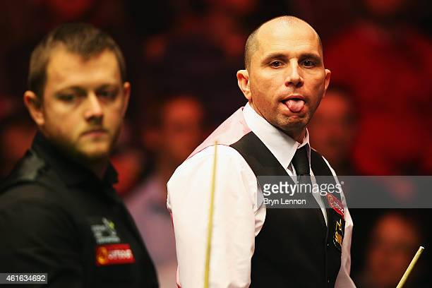 Joe Perry of Great Britain looks on during his quarterfinal match against Mark Allen on day six of the Dafabet Masters at Alexandra Palace on January...
