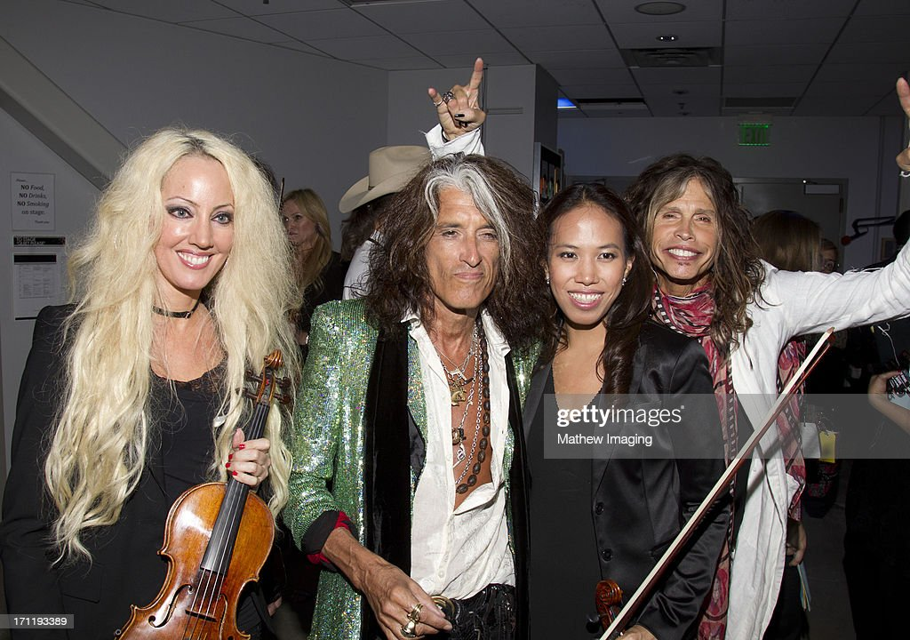 <a gi-track='captionPersonalityLinkClicked' href=/galleries/search?phrase=Joe+Perry+-+Musician&family=editorial&specificpeople=13600677 ng-click='$event.stopPropagation()'>Joe Perry</a>, <a gi-track='captionPersonalityLinkClicked' href=/galleries/search?phrase=Steven+Tyler+-+Musician&family=editorial&specificpeople=202080 ng-click='$event.stopPropagation()'>Steven Tyler</a> and members of the Hollywood Bowl Orchestra attend Hollywood Bowl Opening Night Gala - Inside at The Hollywood Bowl on June 22, 2013 in Los Angeles, California.
