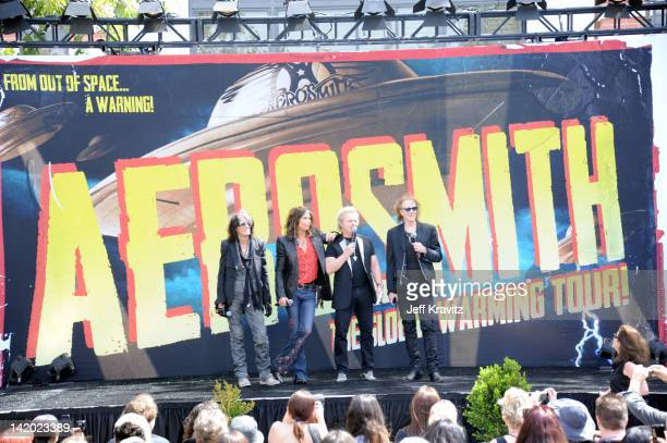 Joe Perry Steven Tyler Joey Kramer and Tom Hamilton attend an Aerosmith press conference at The Grove on March 28 2012 in Los Angeles California