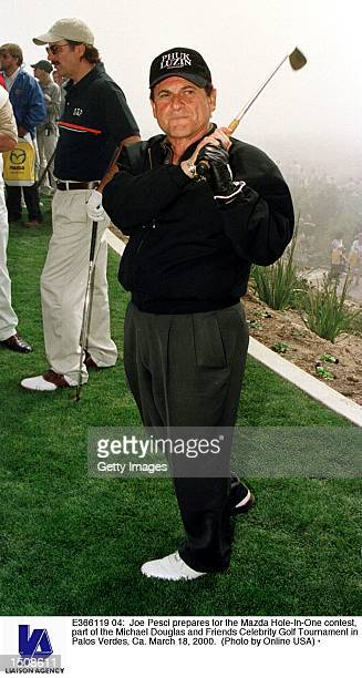 Joe Pesci prepares for the Mazda HoleInOne contest part of the Michael Douglas and Friends Celebrity Golf Tournament in Palos Verdes Ca March 18 2000