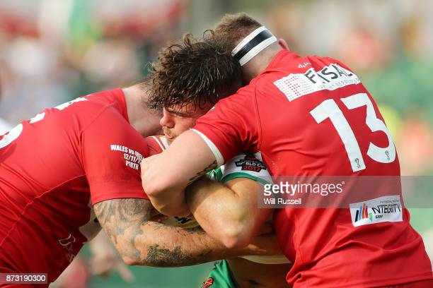 Joe Philbin of Ireland is tackled by Morgan Knowles of Wales during the 2017 Rugby League World Cup match between Wales and Ireland at nib Stadium on...