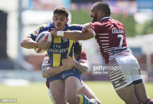 Joe Philbin of Warrington Wolves and Thomas Leuluai of Wigan Warriors in action during the Ladbrokes Challenge Cup QuarterFinal match between...