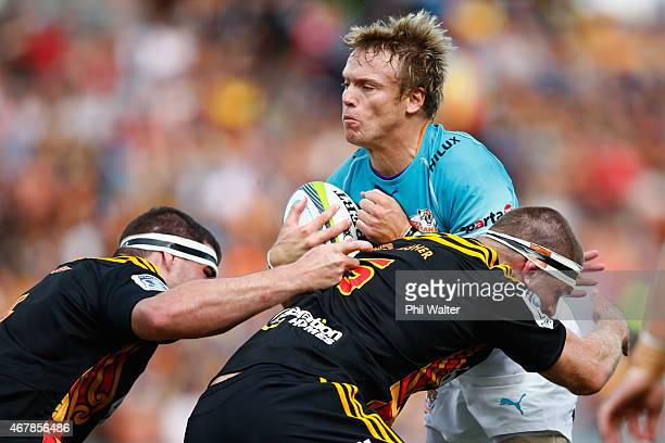 Joe Pietersen of the Cheetahs is tackled during the round seven Super Rugby match between the Chiefs and the Cheetahs at Waikato Stadium on March 28...
