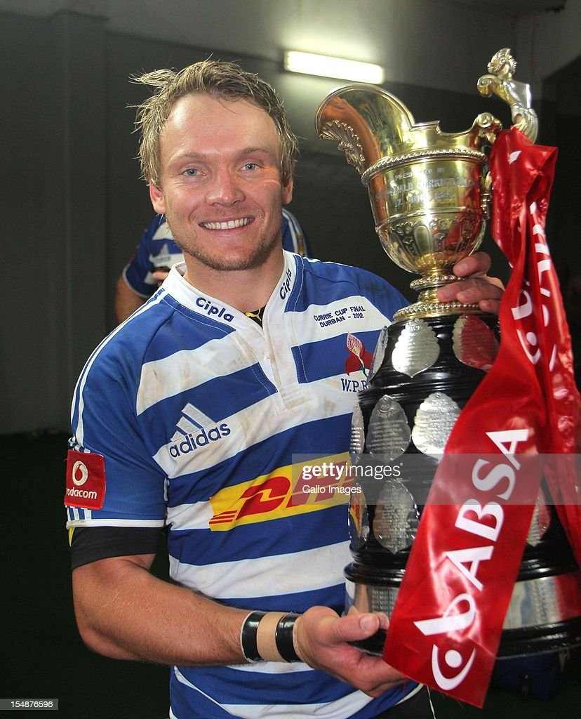 Joe Pietersen of Western Province celebrates with the trophy after the Absa Currie Cup final match between The Sharks and DHL Western Province from Mr Price KINGS PARK on October 27, 2012 in Durban, South Africa.