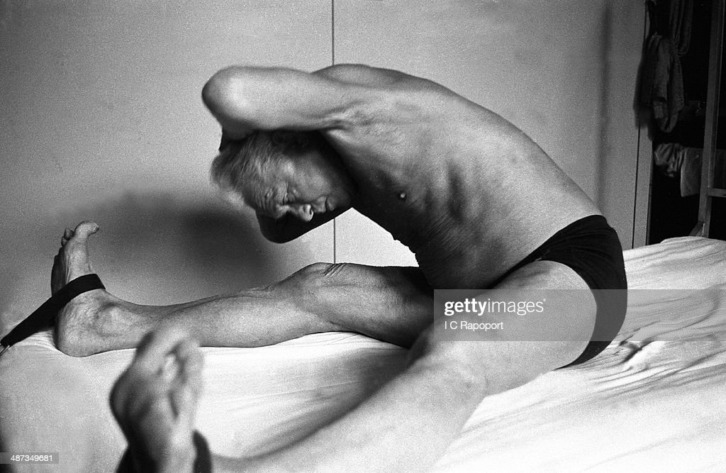 Joe Pilates, Inventor, physical fitness guru and founder of the Pilates exercise method demonstrates his techniques in his 8th Avenue studio on October 4, 1961 in New York City, New York.
