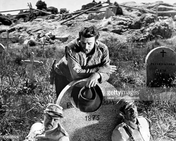 Joe played by American actor Clint Eastwood contemplates two dead soldiers in a graveyard in a promotional still for 'A Fistful of Dollars' directed...