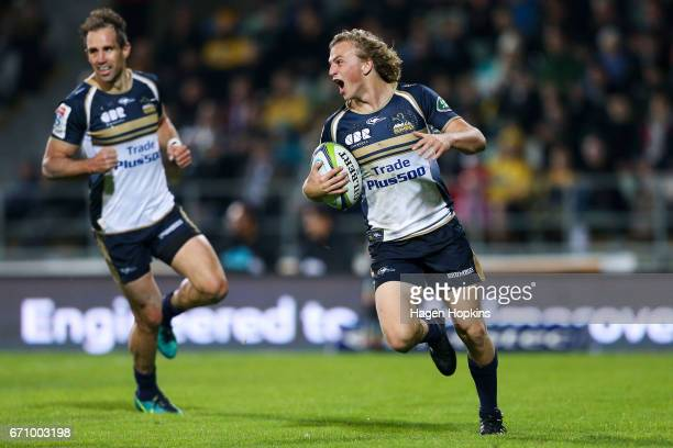 Joe Powell of the Brumbies celebrates before scoring a try while Andrew Smith looks on during the round nine Super Rugby match between the Hurricanes...