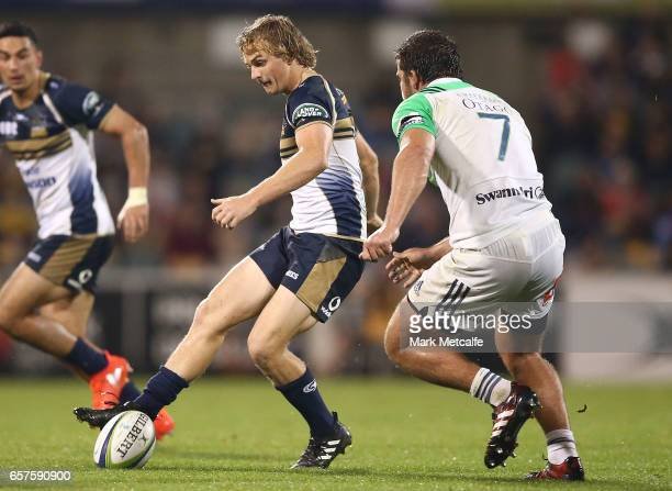 Joe Powell of the Brumbies grubber kicks during the round five Super Rugby match between the Brumbies and the Highlanders at GIO Stadium on March 25...