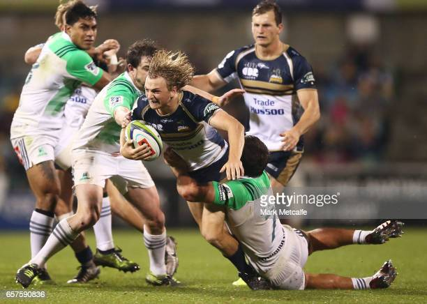 Joe Powell of the Brumbies is tackled by Dillon Hunt of the Highlanders during the round five Super Rugby match between the Brumbies and the...