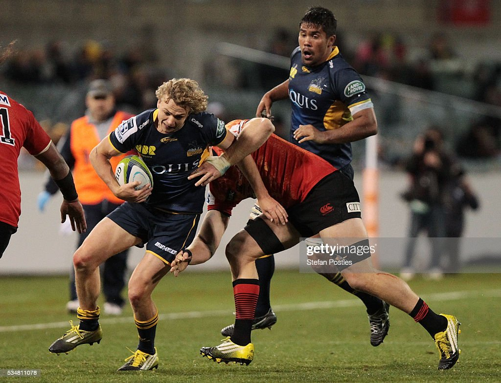 Joe Powell of the Brumbies is tackled during the round 14 Super Rugby match between the Brumbies and the Sunwolves at GIO Stadium on May 28, 2016 in Canberra, Australia.