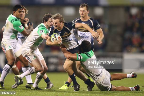 Joe Powell of the Brumbies is tackled during the round five Super Rugby match between the Brumbies and the Highlanders at GIO Stadium on March 25...