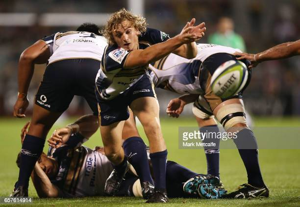 Joe Powell of the Brumbies passes during the round five Super Rugby match between the Brumbies and the Highlanders at GIO Stadium on March 25 2017 in...