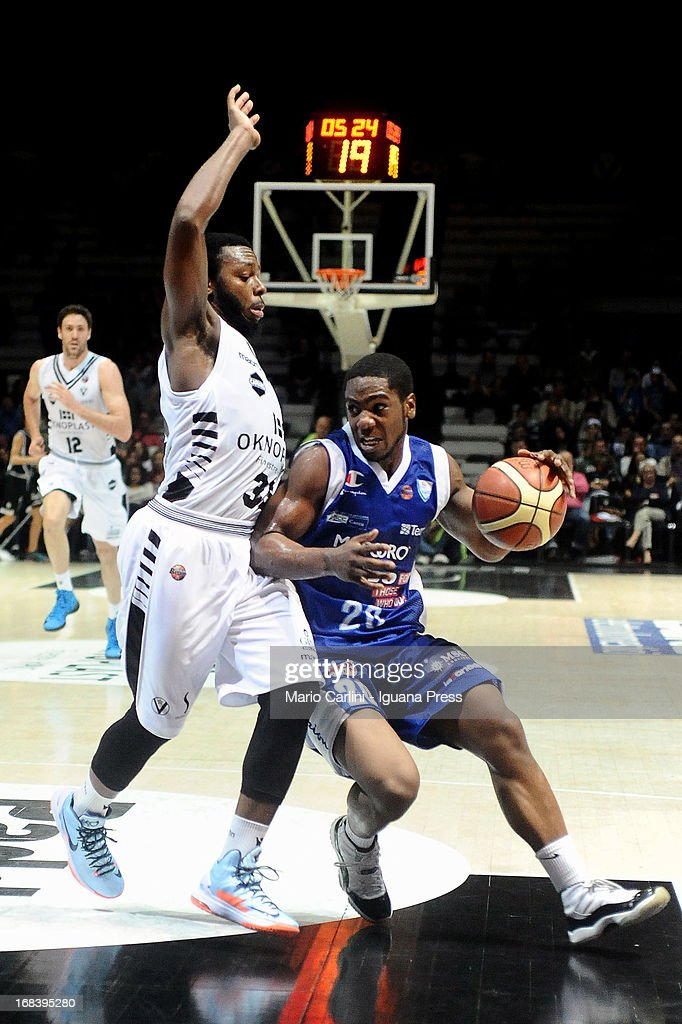 Joe Ragland of Lenovo competes with Jacob Pullen of Oknoplast during the LegaBasket A1 basketball match between Oknoplast Bologna and Lenovo Cantu at Unipol Arena on May 5, 2013 in Bologna, Italy.
