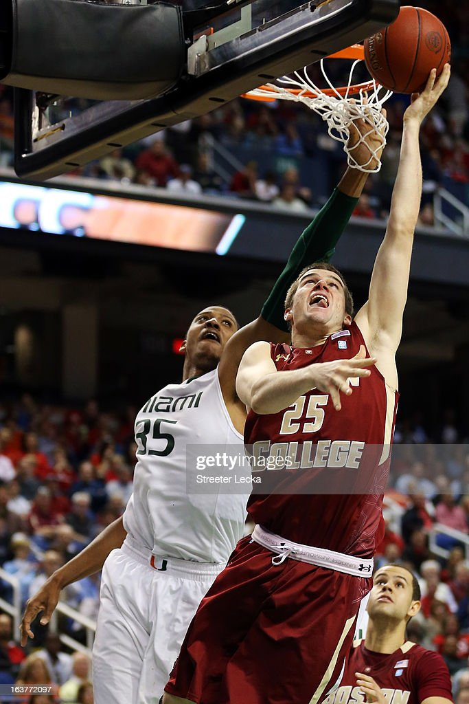 Joe Rahon #25 of the Boston College Eagles goes to the hoop against Kenny Kadji #35 of the Miami Hurricanes during the quarterfinals of the ACC Men's Basketball Tournament at the Greensboro Coliseum on March 15, 2013 in Greensboro, North Carolina.