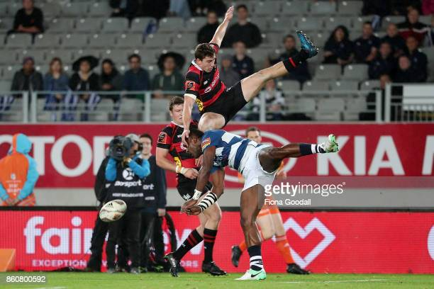 Joe Ravouvou of Auckland goes for the high ball with Josh McKay of Canterbury during the round nine Mitre 10 Cup match between Auckland and...